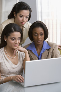 Businesswomen looking at laptop